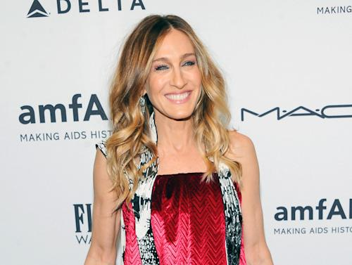 "FILE - This Feb. 6, 2013 file photo shows actress Sarah Jessica Parker at amfAR's New York gala at Cipriani Wall Street in New York. Parker will star in Amanda Peet's off-Broadway play, ""The Commons of Pensacola"" this fall at New York City Center. (Photo by Evan Agostini/Invision/AP, file)"