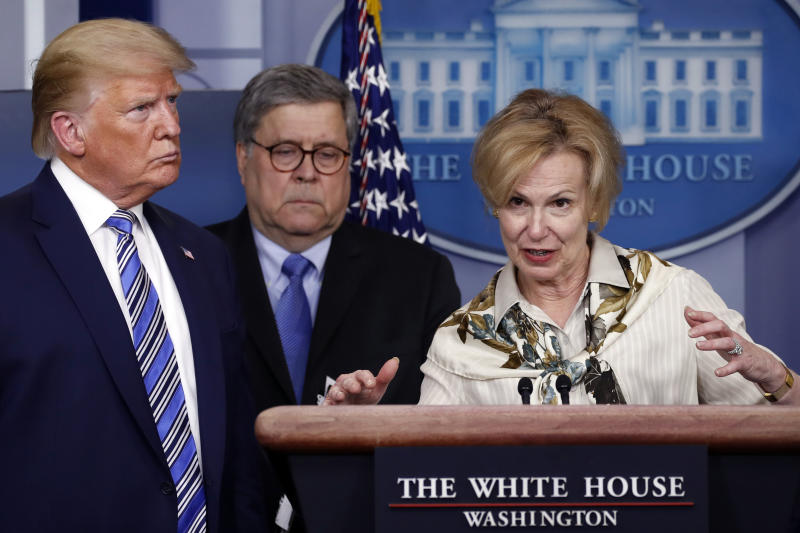 President Donald Trump and Attorney General William Barr listens as Dr. Deborah Birx, White House coronavirus response coordinator, speaks about the coronavirus in the James Brady Briefing Room, Monday, March 23, 2020, in Washington. (AP Photo/Alex Brandon)