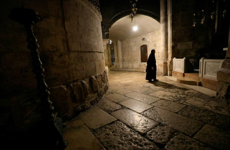 A nun walks along a deserted corridor in the Church of the Holy Sepulchre, believed by Christians to be the burial site of Jesus Christ