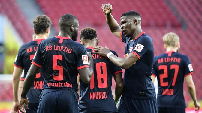 6. RB Leipzig - RB Leipzig menumbangkan finalis Liga Champions musim lalu, Tottenham Hotspur pada babak 16 besar. Keberhasilan melaju ke perempat final merupakan pencapaian terbaik Tim kuda hitam asal Jerman itu. (AFP/Ina Fassbender)