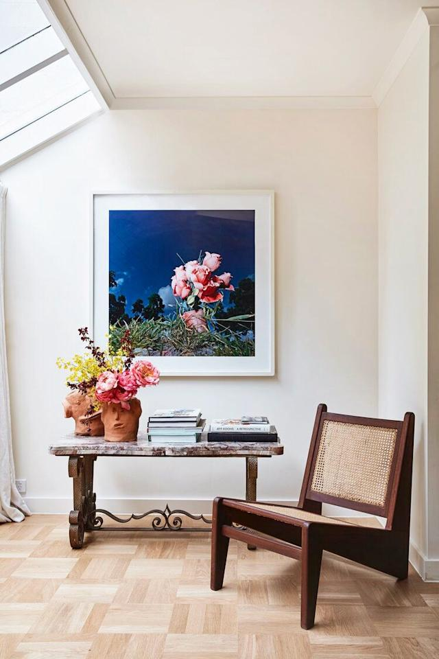 "<p>Take a page from <a href=""https://tamsinjohnson.com/"" target=""_blank"">Tamsin Johnson's</a> console table decorating book and feature florals that reflect the artwork—it's the ultimate way to bring a work of art to life. Even better if you place your arrangement in cheeky vases like these. The contrast between the playful elements and the classic furniture is refreshingly style-forward. </p>"