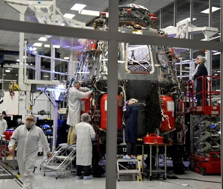 SpaceX technicians work on the next Crew Dragon Demo-2 craft as NASA Administrator Jim Bridenstine tour SpaceX headquarters with NASA astronauts Bob Behnken and Doug Hurley in Hawthorne