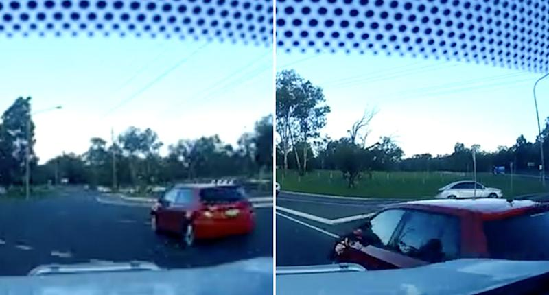 Two cars shown in a video about to crash at the exit of a roundabout at Ingleburn. They were in separate lanes and it's caused confusion as to who was at fault.