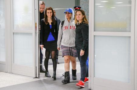 Rahaf Mohammed al-Qunun (C) accompanied by Canadian Minister of Foreign Affairs Chrystia Freeland (R) and Saba Abbas, general counsellor of COSTI refugee service agency, arrives at Toronto Pearson International Airport in Toronto, Ontario, Canada January 12, 2019.  REUTERS/Carlos Osorio