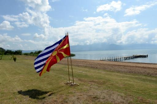 The flags of Greece and Macedonia flutter on the shores of Lake Prespa where last June's historic name deal was signed