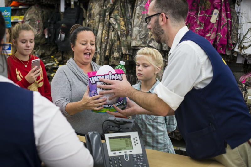 IMAGE DISTRIBUTED FOR WALMART - Kelly Ingram reacts while receiving a Hatchimal, a top toy of the season, at Walmart's Black Friday event in Bentonville, AR on Nov. 24, 2016. (Gunnar Rathbun/AP Images for Walmart)