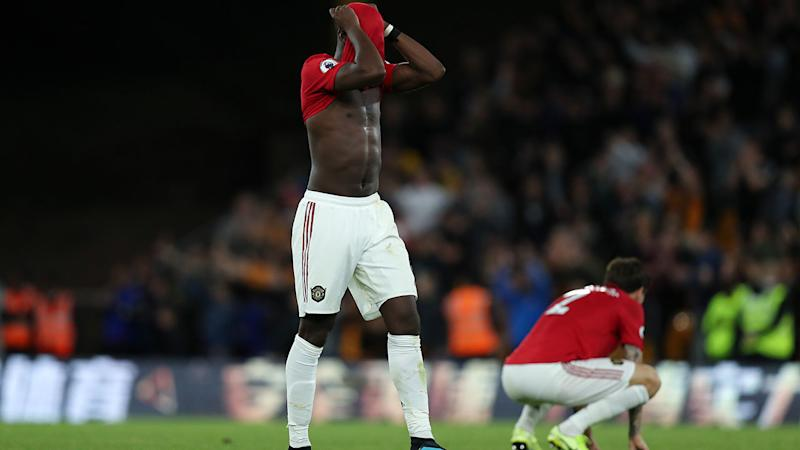 Paul Pogba, pictured here after his missed penalty. (Photo by Matthew Ashton - AMA/Getty Images)