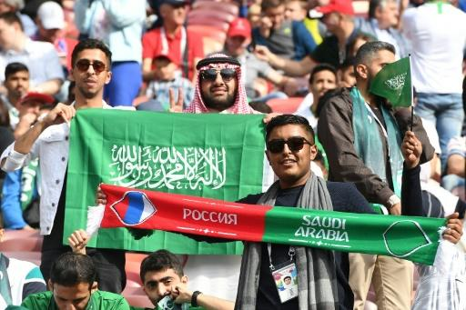 Saudi Arabia fans hold scarves and flags before the start of the Russia 2018 World Cup Group A football match between Russia and Saudi Arabia at the Luzhniki Stadium in Moscow on June 14, 2018