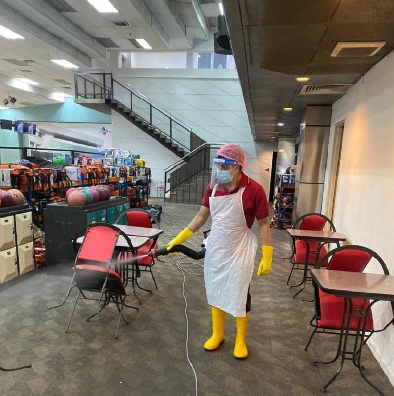 An employee disinfects the premises of Sunway Mega Lanes in preparation for reopening of the bowling centre in Subang Jaya. — Picture courtesy of Sunway Mega Lanes