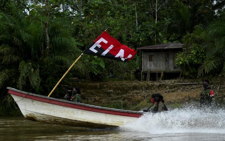 ELN guerrillas patrol a jungle river in Colombia's Choco department on May 23, 2019
