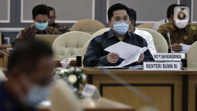 Menteri BUMN Erick Thohir saat rapat bersama DPR di Ruang Pansus B Gedung Nusantara II, Kompleks Parlemen, Jakarta, Rabu (13/5/2020). Rapat membahas antisipasi skema penyelamatan perbankan akibat COVID-19 ini juga diikuti Gubernur BI, Pimpinan BIN, hingga Pimpinan KPK. (Liputan6.com/Johan Tallo)