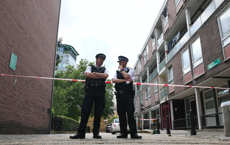 Police guard the cordon in Munster Square following the killing (PA)