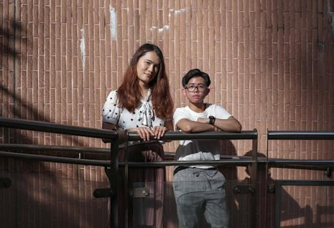 Alice Ho (left) and Liam Mak pose together in Yau Ma Tei. Photo: Xiaomei Chen