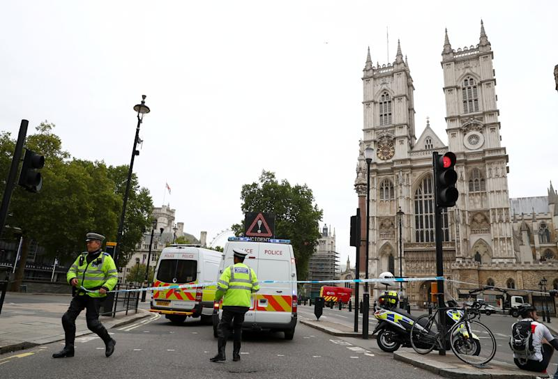Police cordon the site of a suspected terror attack where a car crashed outside Houses of Parliament in Westminster, London.
