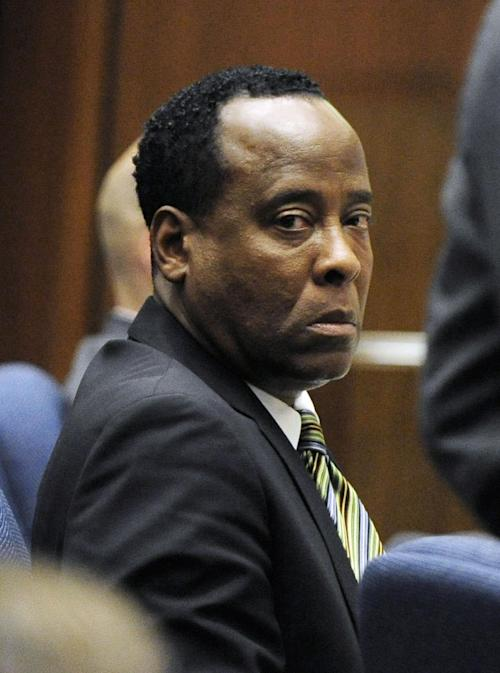 "FILE - In this Oct. 27, 2011 file photo, Dr. Conrad Murray listens to testimony by Dr. Paul White, an anesthesiologist and propofol expert, during Dr. Conrad Murray's involuntary manslaughter trial in Los Angeles. Jurors throughout an 18-week civil trial in Los Angeles have heard about Jackson and Murray's relationship, including a story about the cardiologist accompanying Jackson to a 2007 visit with a plastic surgeon in Las Vegas and paying for the procedure himself. Defense attorneys for AEG Live LLC, who are being sued by Jackson's mother claiming the company hired Murray for the ill-fated ""This Is It"" shows, have presented testimony about Jackson's relationship with many of his doctors throughout the 1990s and 2000s. (AP Photo/Paul Buck, Pool, File)"
