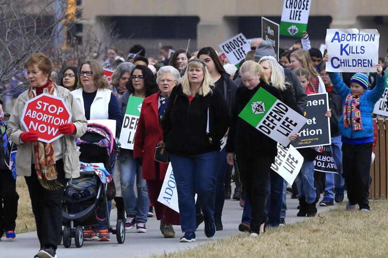 FILE - In this Jan. 23, 2017, file photo, marchers arrive for a Roe v. Wade protest as hundreds converge on the Kansas Statehouse in Topika, Kan. Top Kansas Republicans are pushing to overturn a state Supreme Court decision that protects abortion rights but say they can't get enough support to ban abortion.The Legislature expects to consider a proposed amendment to the Kansas Constitution during the annual 90-day lawmaking session set to convene Monday, Jan. 13, 2020. It's a response to the state high court's ruling in April that the state's Bill of Rights makes access to abortion a fundamental right. (AP Photo/Orlin Wagner, File)
