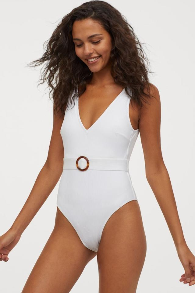 """<p>Not only is this <a href=""""https://www.popsugar.com/buy/HampM-Ribbed-Belted-Swimsuit-574176?p_name=H%26amp%3BM%20Ribbed%20Belted%20Swimsuit&retailer=www2.hm.com&pid=574176&price=35&evar1=fab%3Aus&evar9=46104329&evar98=https%3A%2F%2Fwww.popsugar.com%2Ffashion%2Fphoto-gallery%2F46104329%2Fimage%2F47474568%2FHM-Ribbed-Belted-Swimsuit&list1=shopping%2Cswimwear%2Csummer%20fashion%2Cswimsuits&prop13=api&pdata=1"""" rel=""""nofollow"""" data-shoppable-link=""""1"""" target=""""_blank"""" class=""""ga-track"""" data-ga-category=""""Related"""" data-ga-label=""""https://www2.hm.com/en_us/productpage.0859942001.html"""" data-ga-action=""""In-Line Links"""">H&amp;M Ribbed Belted Swimsuit</a> ($35) comfy, it's also so flattering.</p>"""