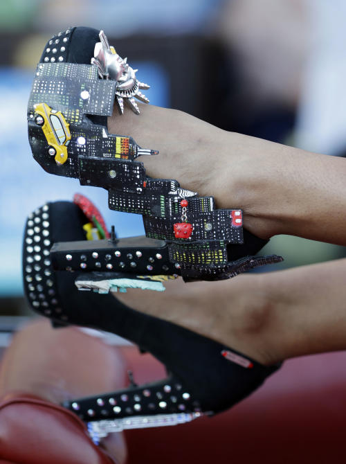 Miss New York Nina Davuluri displays her shoes during the Miss America Shoe Parade at the Atlantic City boardwalk, Saturday, Sept. 14, 2013, in Atlantic City, N.J. (AP Photo/Julio Cortez)