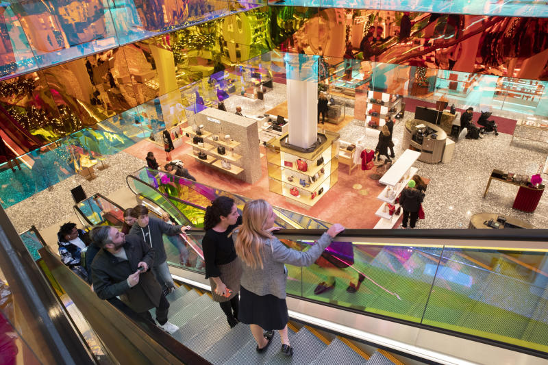 FILE - In this Nov. 26, 2019, photo customers ride the escalators designed by Dutch architect Rem Koolhaas at the Saks Fifth Avenue Flagship in New York. The nation's largest retail trade group said Thursday, Jan. 16, 2020, that holiday sales increased 4.1%, near the top end of its forecast. (AP Photo/Mary Altaffer, File)