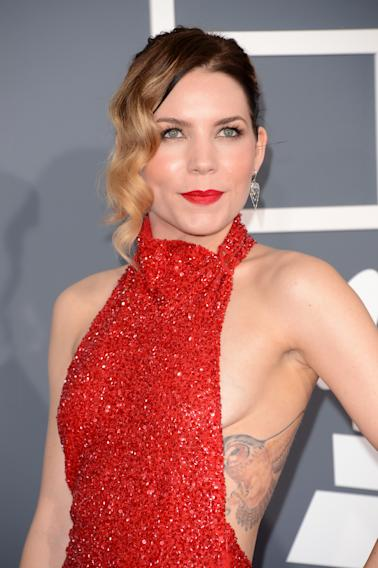 Skylar Grey was confident enough to bare her sides, showing off her tatt and the curvature of her breasts.