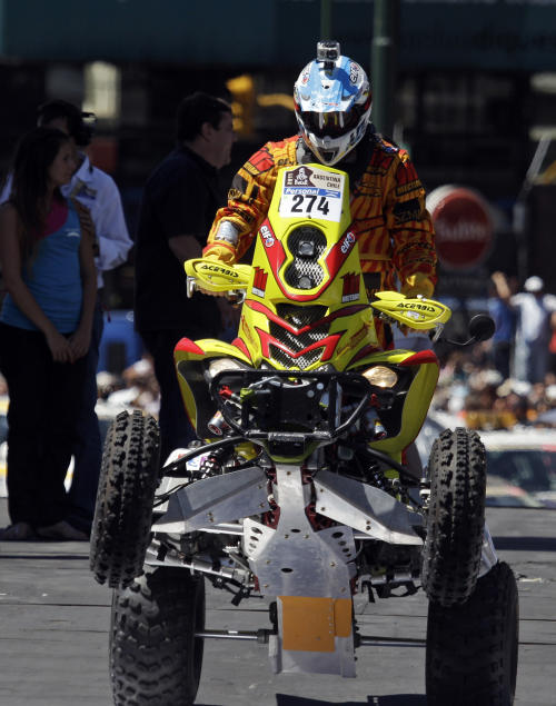 FILE - In this Saturday Jan. 1, 2011 file photo, Argentina's Nicolas Mangiantini, carrying a camera on his helmet, rides his Yamaha quad during the 2011 Argentina-Chile Dakar Rally symbolic start in Buenos Aires, Argentina. For adventure athletes, it's the new essential: a video of their exploits. Now only video action will do for a shoot-it-and-share-it generation of skiers and skydivers, snowboarders and bike riders. (AP Photo/Eduardo Di Baia, File)