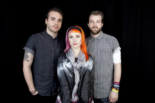 This April 8, 2013 photo shows from left, Taylor York, Hayley Williams and Jeremy Davis, of the American rock band Paramore posing for a portrait in New York. (Photo by Amy Sussman/Invision/AP)