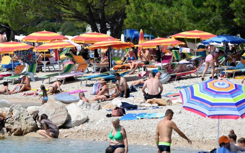 Sunbathers in Croatia - DENIS LOVROVIC/AFP via Getty Images