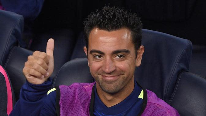 Xavi Hernandez saat masih memperkuat Barcelona. (Lluis Gene/AFP)