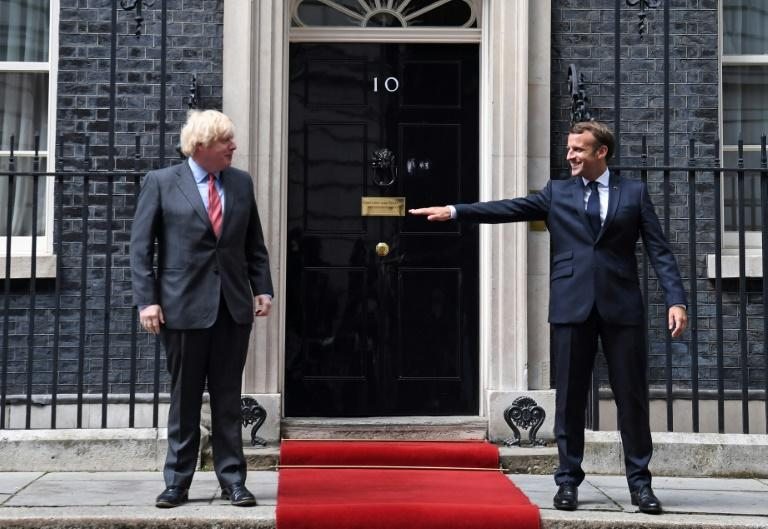 Keeping his distance: French President Emmanuel Macron socially  distanced from hs host Boris Johnson outside 10  Downing Street