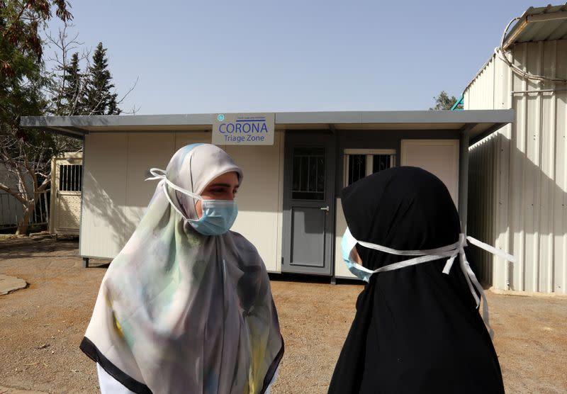 Nurses stand outside a Coronavirus triage zone at Saint Georges hospital Hadath