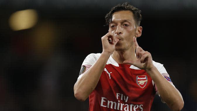7. Mesut Ozil (28,7 juta dolar) - Ozil memperoleh 28,7 juta dolar dari 23,2 juta dolar gaji dan bonus serta 5,5 juta dolar dari iklan. (AFP/Ian Kington)