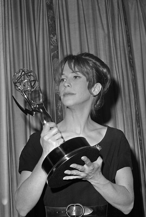 File-This May 22, 1962 file photo shows Julie Harris posing with her Emmy statuette she received at the Emmy Awards in New York City. Harris, who won an unprecedented five Tony Awards for best actress, has died. She was 87. Actress and family friend Francesca James says Harris died Saturday Aug. 24, 2013 at her home in West Chatham, Mass. She had previously suffered two strokes. (AP Photo/File)
