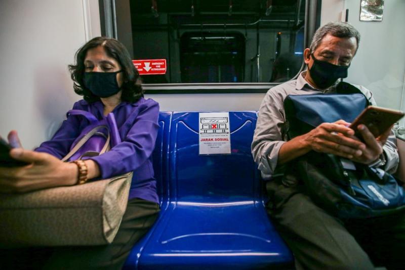 Passengers heed Prasarana's social distancing advice on board an LRT train March 24, 2020. — Picture by Hari Anggara