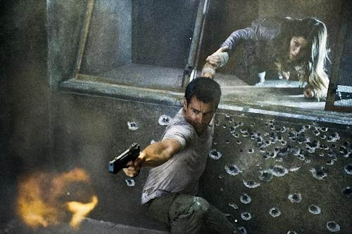 "This film image released by Columbia Pictures shows Jessica Biel, right, and Colin Farrell in a scene from the action thriller ""Total Recall."" (AP Photo/Columbia Pictures - Sony, Michael Gibson)"