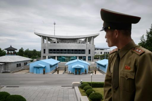 A North Korean solider stares at the South Korean side of the Panmunjom truce village
