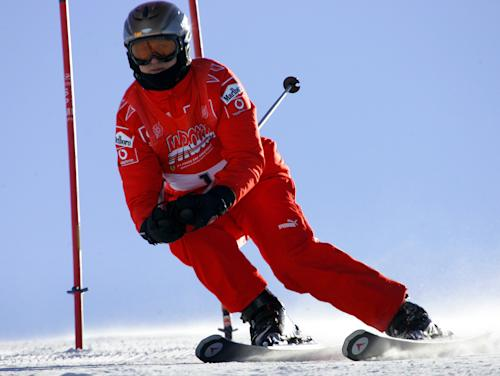 FILE - In this Friday, Jan. 13, 2006 file photo, Ferrari driver Michael Schumacher of Germany speeds down a course in Madonna di Campiglio, Italy. Schumacher is in this Italian Alps ski resort for the yearly meeting between Ferrari drivers and the press. Two minutes of footage from a camera on Michael Schumacher's ski helmet showed the Formula One great was clearly skiing off a groomed trail when he lost his balance and crashed, leaving him with critical head injuries, investigators said Wednesday Jan. 8, 2014. (AP Photo/Luca Bruno, File)