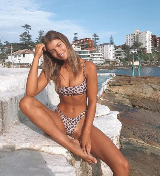 Australian model and Instagram influencer Kristina Mendonca reveals who takes her bikini photos on social media