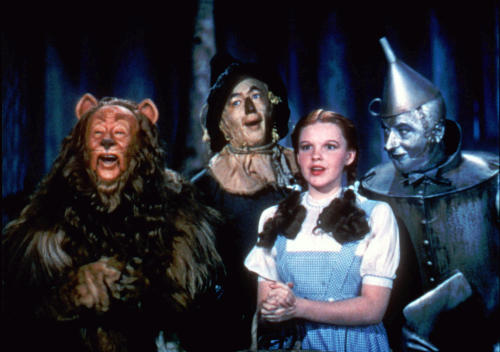 """FILE- This 1939 file photo provided by Warner Bros. shows, from left, Bert Lahr as the Cowardly Lion, Ray Bolger as the Scarecrow, Judy Garland as Dorothy and Jack Haley as the Tin Woodman in a scene from """"The Wizard of Oz."""" Judy Garland's original costume from """"The Wizard of Oz"""" will be up for sale at Julien's Auctions in November 2012. (AP Photo/Warner Bros., File)"""