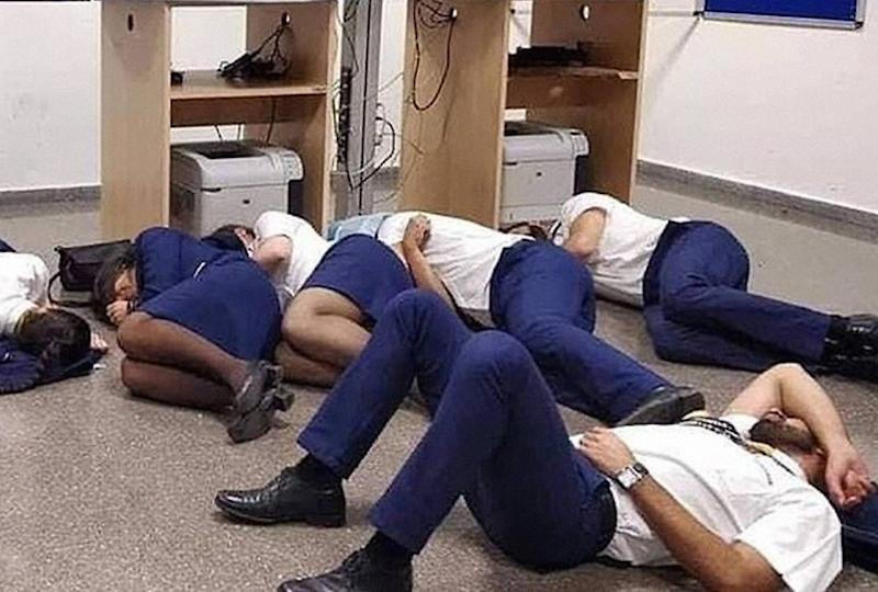 So-called truth behind staged photo of Ryanair airline staff 'sleeping' on the floor.