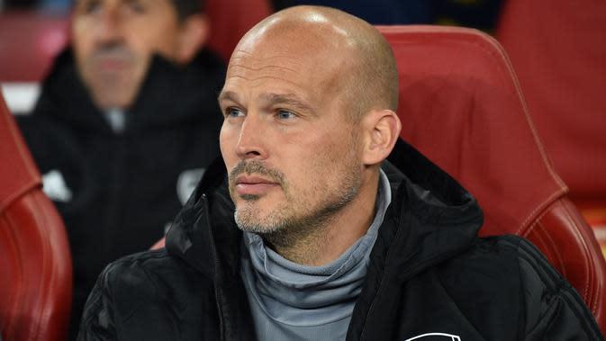 Pelatih caretaker Arsenal, Freddie Ljungberg mendapat dukungan dari mantan pemain, Ray Parlour (Glyn KIRK / AFP)