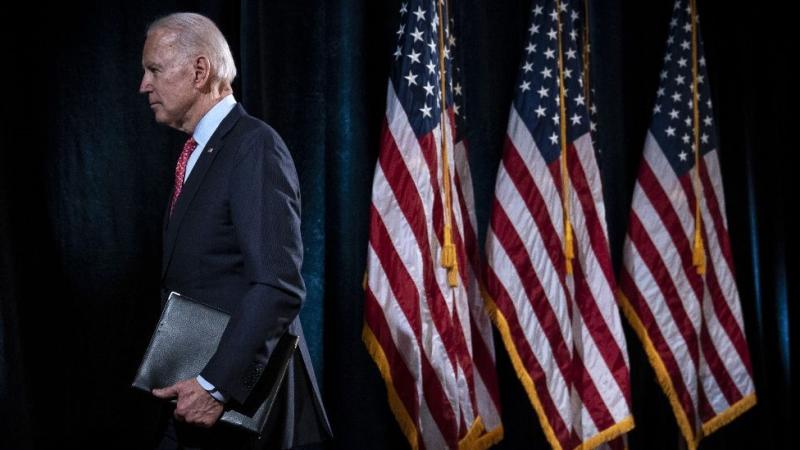 Joe Biden walks off stage.
