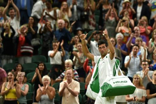 I'll be back: Novak Djokovic leaves the court after play was suspended