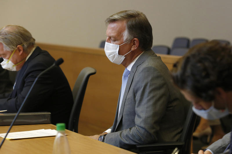 Bill Smith, interim chief executive officer and president of PG&E Corp., listens as Butte County Superior Court Judge Michael Deems announces the penalties for its role in the 2018 Camp Fire, during the criminal sentencing hearing in the trial of Pacific Gas & Electric Corp in Chico, Calif., Thursday, June 18, 2020. PG&E received the maximum fine of $3.5 million for its crimes and an additional $500,000 for the cost of the investigation into the cause of the wildfire. The utility company pleaded guilty, Tuesday, to 84 felony counts of involuntary manslaughter for the fire that wiped out the town of Paradise. (AP Photo/Rich Pedroncelli)
