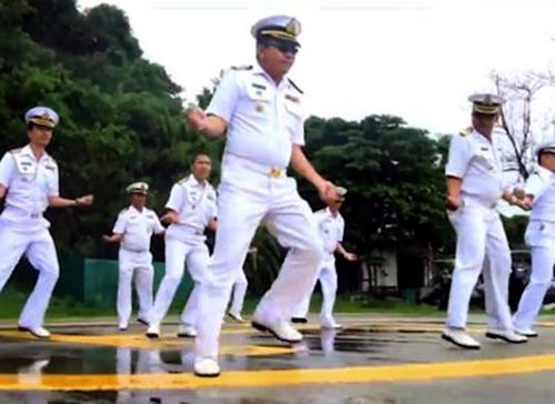 "In this image made from an undated video released by Thai Royal Navy, Thai sailors perform the rodeo-style dance and other hip-shaking moves at their base on the popular tourist island of Phuket, southern Thailand. The ""Gangnam Style"" craze has reached Thailand's navy, which is among the latest to mimic the globally popular dance video by South Korean singer PSY. (AP Photo/Royal Thai Navy) EDITORIAL USE ONLY, NO SALES"
