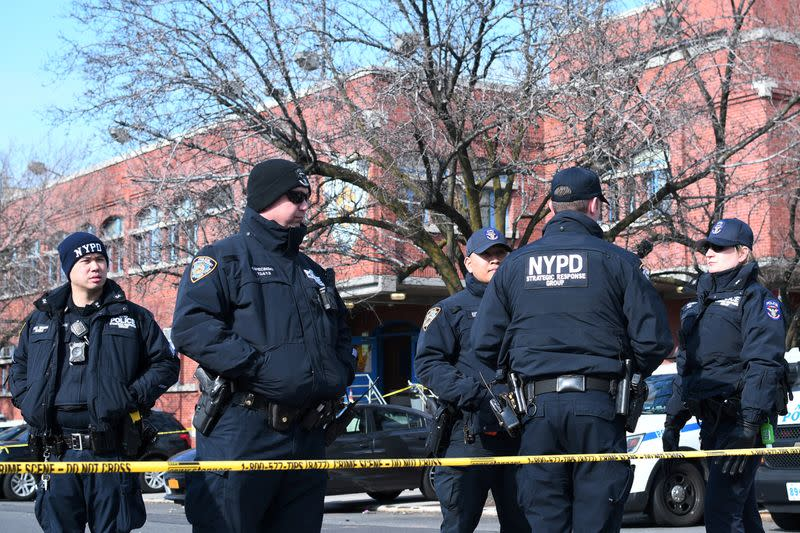 FILE PHOTO: New York Police Department officers gather outside of the 41st Precinct in the Bronx borough of New York after a shooting there in New York City