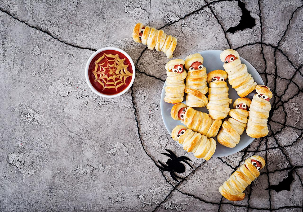 """<p>If you're hosting a Halloween party this year, look no further: We've got the best Halloween appetizers you need to complement your <a href=""""https://www.countryliving.com/food-drinks/g1031/halloween-menu-ideas/"""">Halloween menu ideas</a>—and they're just as delicious as they are spooky. Each one of these Halloween party food ideas is easy to throw together, fun to stare at, and is sure to have guests asking for the recipe.</p><p>To make the evening even more wickedly delicious though, we recommend serving these Halloween snacks with spellbinding <a href=""""https://www.countryliving.com/food-drinks/g2640/halloween-cocktails/"""">cocktails</a> and a few sweet <a href=""""https://www.countryliving.com/food-drinks/g1194/halloween-treats/"""">Halloween treats</a>, too. You could whip up a batch of <a href=""""https://www.countryliving.com/food-drinks/g2651/halloween-cookies/"""">Halloween cookies</a>, for instance, or bookend your table with a dozen <a href=""""https://www.countryliving.com/food-drinks/g1366/halloween-cupcake-ideas/"""">Halloween cupcakes</a>. Why stop there? We've got recipes for entire <a href=""""https://www.countryliving.com/food-drinks/g604/halloween-cake-recipes-1008/"""">Halloween cakes</a>, including a mile-high """"haunted house cake"""" that's bound to have everyone talking. Talk about a tasty way to get the party started—or finished! </p><p>Of course, we know you're not looking for more work right now. Odds are you've spent weeks preparing for your event, from crafting a cute costume for yourself, making <a href=""""https://www.countryliving.com/diy-crafts/g1360/halloween-costumes-for-kids/"""">Halloween costumes for kids</a> (<em><a href=""""https://www.countryliving.com/shopping/news/g4786/hocus-pocus-costume-collection/"""">Hocus Pocus</a></em><a href=""""https://www.countryliving.com/shopping/news/g4786/hocus-pocus-costume-collection/""""> costumes</a>, anyone?)<em></em>, and crafting all the decorations too. You won't want to spend hours in the kitchen making all the bites, right? Luckily"""