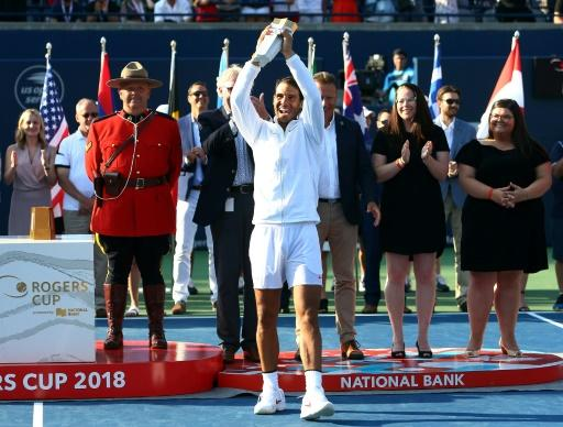 Rafael Nadal of Spain holds up the champions trophy after defeating Stefanos Tsitsipas of Greece in the final of the Rogers Cup, at Aviva Centre in Toronto, on August 12, 2018