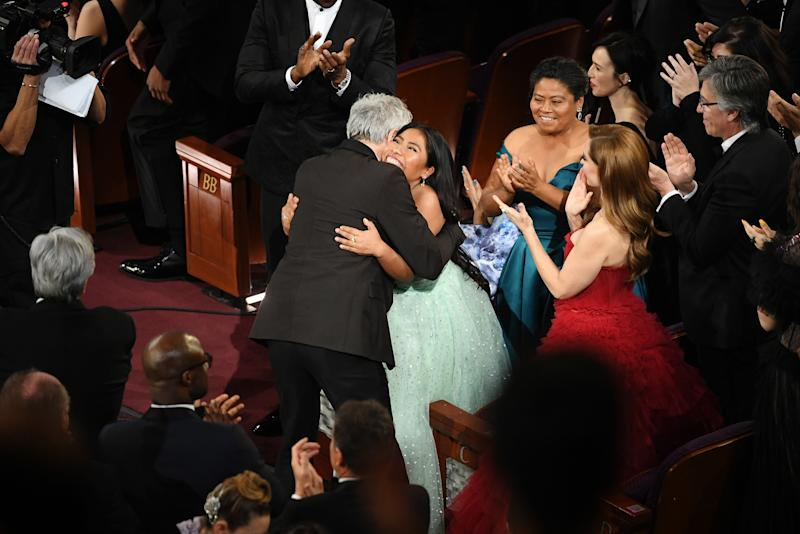 Yalitza Aparicio hugs Alfonso Cuaron after Cuaron won the Cinematography award for 'Roma' during the 91st Annual Academy Awards on Feb. 24, 2019. | Kevin Winter—Getty Images