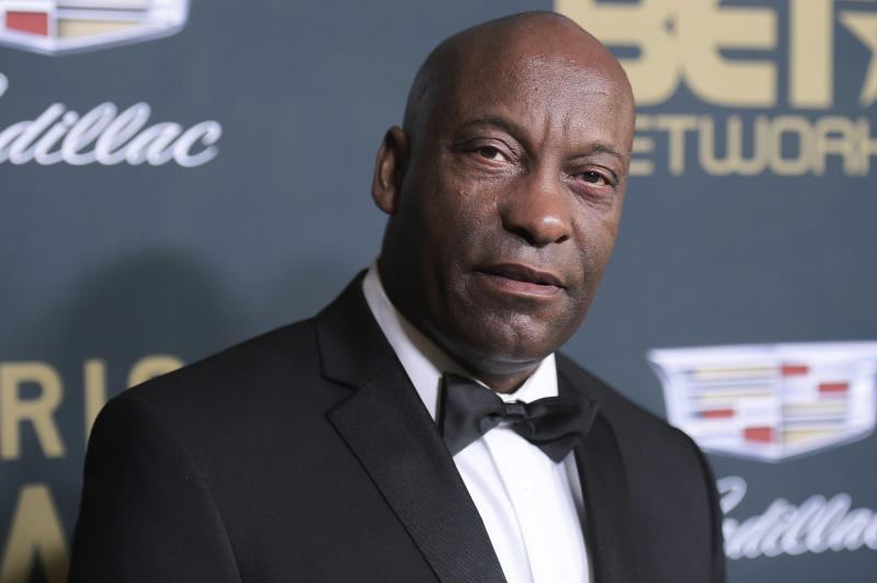 """FILE - In this Sunday, Feb. 25, 2018 file photo, John Singleton attends the 2018 American Black Film Festival Honors at the Beverly Hilton Hotel in Beverly Hills, Calif. In April, Hollywood lost director John Singleton, whose 1991 film """"Boyz N the Hood"""" was praised as a realistic and compassionate take on race, class, peer pressure and family. He became the first black director to receive an Oscar nomination and the youngest at 24. (Photo by Richard Shotwell/Invision/AP, File"""
