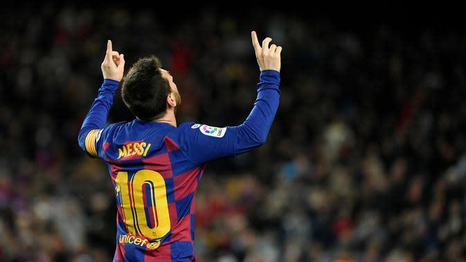 Striker Barcelona, Lionel Messi, merayakan gol ke gawang Granada (LLUIS GENE / AFP)